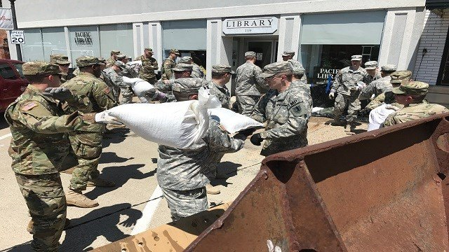 The National Guard assisting with sandbag clean up in Pacific. (Credit: KMOV)