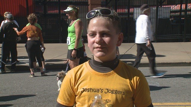 "Joshua Fields, runner with visual impairments, at the ""Run for Sight"" event Sunday morning. (Credit: KMOV)"