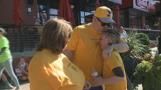 "Fields and his family wearing ""Joshua's Joggers"" shirts at the ""Run for Sight"" event. (Credit: KMOV)"