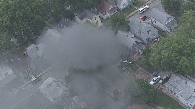 News 4 on the scene of a house fire that broke out in South City. (Credit: KMOV)