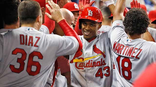 St. Louis Cardinals' Magneuris Sierra (43) is congratulated by teammates after scoring on a triple by Dexter Fowler during the sixth inning of a baseball game against the Miami Marlins, Wednesday, May 10, 2017, in Miami. (AP Photo/Wilfredo Lee)