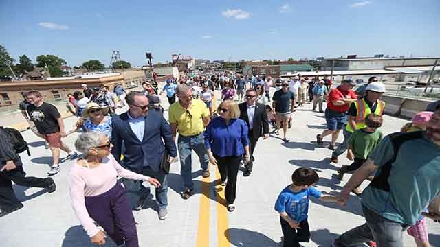 St. Louis Mayor Lyda Krewson leads a deligation of residents and friends across the Kingshighway Bridge after a ribbon cutting ceremony reopening the bridge in St. Louis on May 13, 2017. (Bill Greenblatt/UPI)