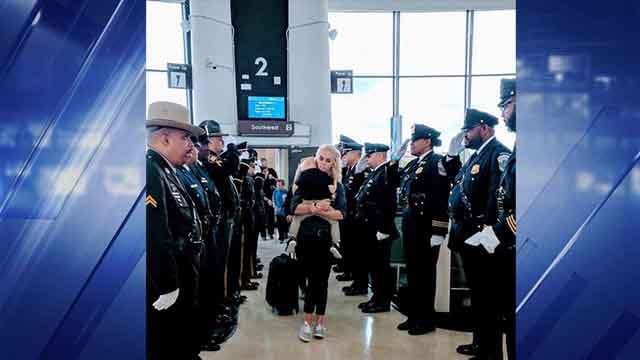 Elizabeth Snyder, wife of Blake Snyder, arrives at the airport for the Candelight Vigil for Fallen Officers in Washington D.C. (Credit: Elizabeth Snyder)