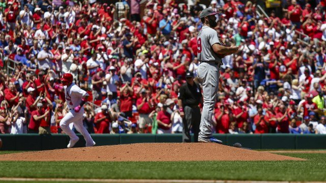 Chicago Cubs starting pitcher Jake Arrieta, right, stands on the mound as St. Louis Cardinals' Yadier Molina, background, rounds third after hitting a two-run home run during the second inning of a baseball game Sunday, May 14, in St. Louis. AP Photos