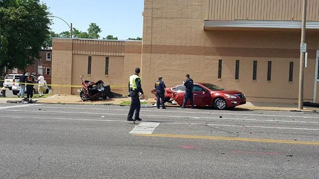 Crews at Shreve and Natural Bridge following a crash Tuesday (Credit: Brian Howe / KMOV)