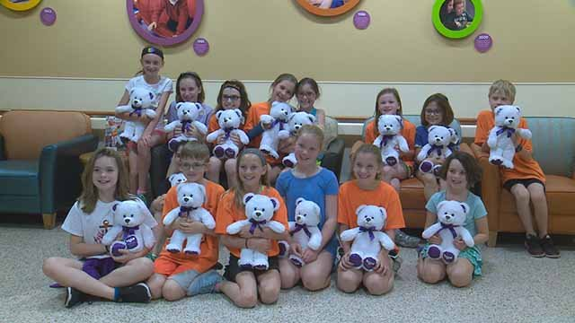Students from Bristol Elementary with heartbeat bears they presented to parents who've lost newborns. Credit: KMOV