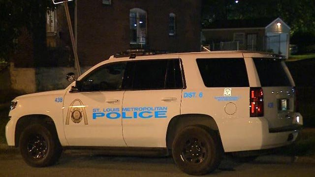 Police vehicle in the 4900 block of San Francisco after a child was shot Tuesday (Credit: KMOV)