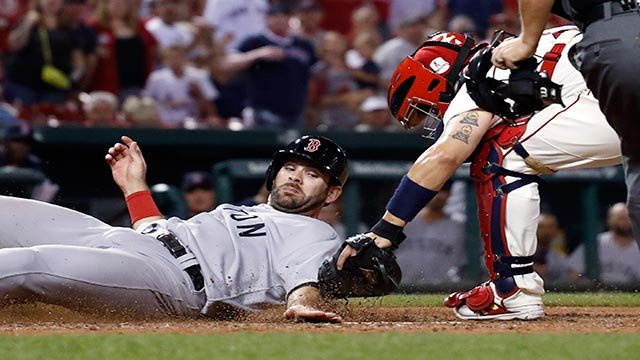Boston Red Sox's Mitch Moreland, left, is tagged out by St. Louis Cardinals catcher Yadier Molina during the eighth inning of a baseball game Tuesday, May 16, 2017, in St. Louis. (AP Photo/Jeff Roberson)