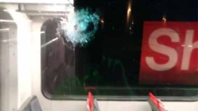 Bullet hole in window of MetroLink train on Tuesday, May 16, in Fairview Heights, Illinois. (Credit: Rebecca Steele Crump / Facebook)