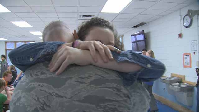 The Surprise Squad surprised two daughters who had not seen their soldier father in 15 months. Credit: KMOV