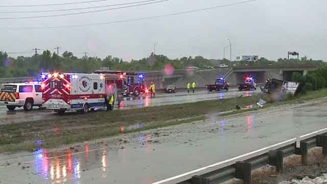 Crews attend to the scene of an overturned tractor trailer on Westbound I-70 near TR Hughes Blvd on Saturday, May 17, 2017 (Credit: KMOV)