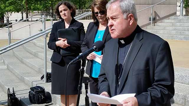 "St. Louis Archbishop Robert Carlson speaks at a news conference Monday, May 22, 2017, announcing a federal lawsuit to stop a St. Louis ordinance that prohibits discrimination based on ""reproductive health decisions."" (AP Photo/Jim Salter)"