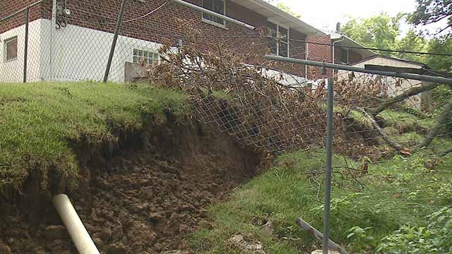 Several homeowners along Belcrest Drive in St. John say their backyards are sinking. Credit: KMOV