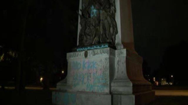 Spray paint seen on the Confederate Monument in Forest Park early Wednesday morning (Credit: KMOV)