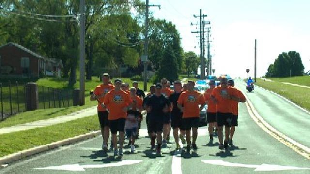 Officers participating in the Torch Run (Credit: KMOV)