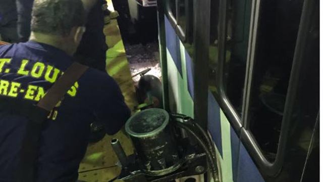Firefighters working to free a man who became trapped at the Central West End MetroLink station Thursday night (Credit: St. Louis Fire Department / Twitter)