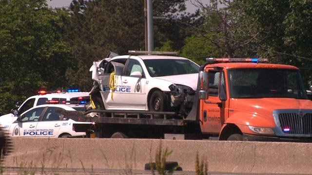 A damaged police vehicle in on a tow truck in the express lanes of I-70 Friday (Credit: KMOV)