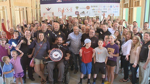 Fellow police officers, community leaders, friends and family turned out for a special honor for injured Ballwin police officer Michael Flamion at the Walls of Honor event. (Credit: KMOV)