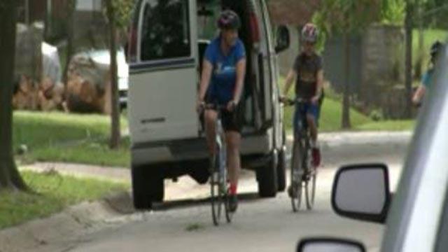 Darcy Nayler riding her bicycle (Credit: KMOV)