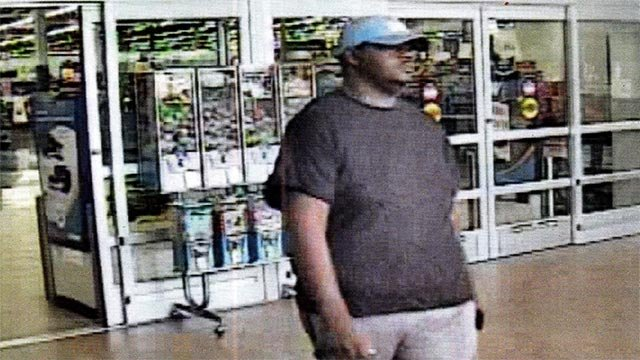 A suspect believed to have used a stolen credit card at a Manchester Walmart (Credit: Town & Country Police)