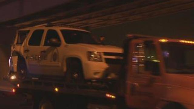 St. Louis Police cruiser being towed away following a crash Monday morning (Credit: KMOV)