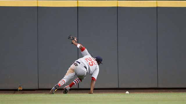 Dexter Fowler tries to play a two-run double hit by Eugenio Suarez of the Cincinnati Reds in the seventh inning of a game at Great American Ball Park on June 5, 2017 in Cincinnati, Ohio. The Reds defeated the Cardinals 4-2. Photo by Joe Robbins/Getty