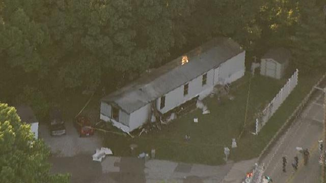 A mobile home on Glen Crossing Road caught fire Tuesday (Credit: KMOV)