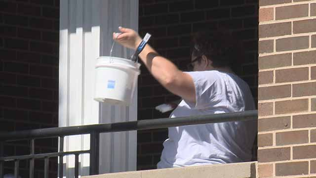 Volunteers from Sherwin-Williams painted Ronald McDonald houses Wednesday. Credit: KMOV