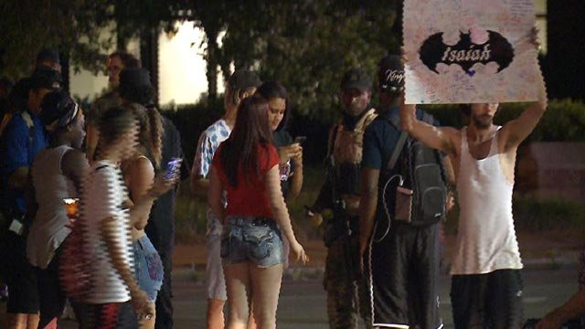 Protester holding sign in South City Wednesday night (Credit: KMOV)