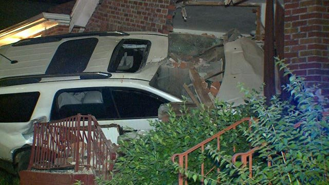 An SUV hit a vacant home on Goodfellow Thursday (Credit: KMOV)
