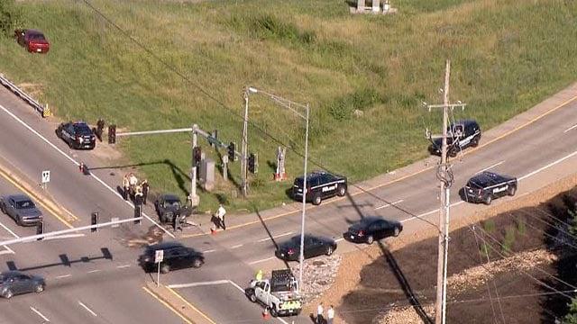 Officials on Manchester at I-270 after a crash Thursday (Credit: KMOV)