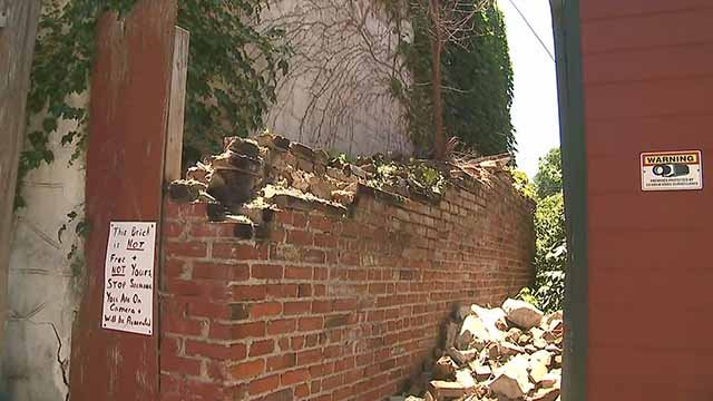 Peggy Ladd says she her request to tear down this crumbling home in Benton Park is being denied. Credit: KMOV