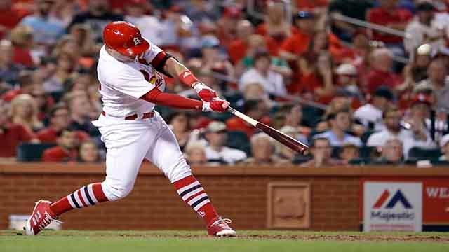 St. Louis Cardinals' Aledmys Diaz hits a solo home run during the fifth inning of the team's baseball game against the Philadelphia Phillies on Friday, June 9, 2017, in St. Louis. (AP Photo/Jeff Roberson)