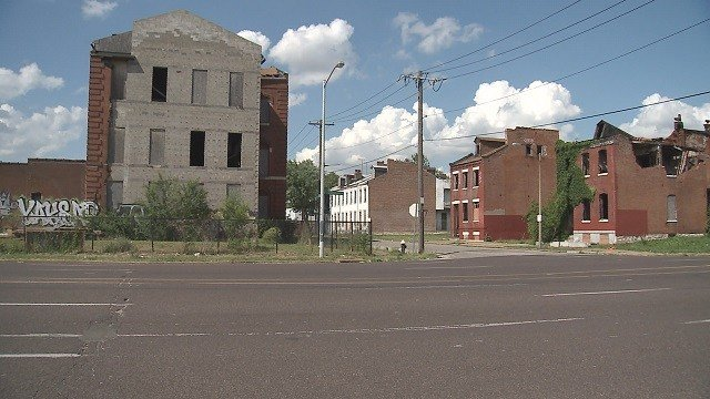 At a town hall on the city's north side, the vacant properties are being marketed as an investment opportunity, bought at auction and rehabbed into rental property. (Credit: KMOV)