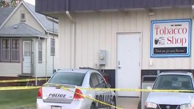 Crime scene tape around a store & vehicles in Jerseyville (Credit: KMOV)