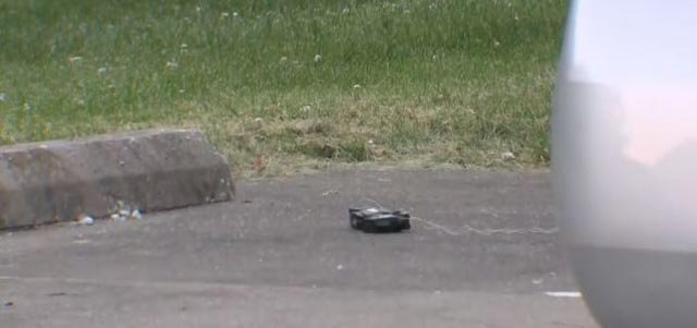 A taser on the ground near a police vehicle (Credit: KMOV)