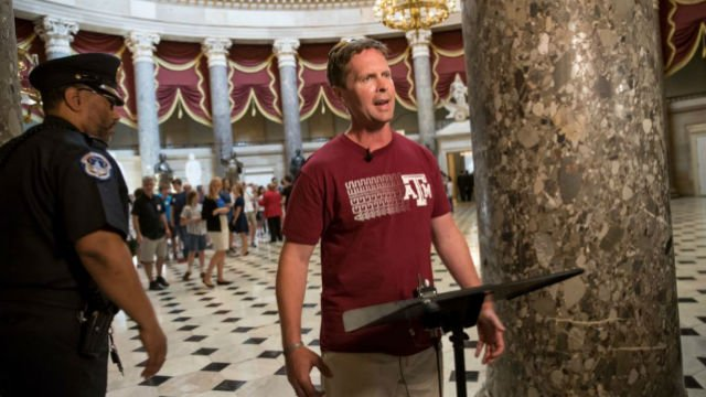 Rep. Rodney Davis, R-Ill., still wearing his baseball shirt, describes for reporters on Capitol Hill in Washington, Wednesday, June 14, 2017, the scene at a congressional baseball practice in Alexandria, Va., (AP Photo/J. Scott Applewhite)