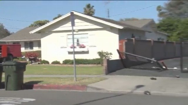 A grandmother was killed, and her infant grandchild was hurt, when a female driver lost control of her car while backing out of a driveway in Anaheim and hit them, police said.(Credit: KTLA)