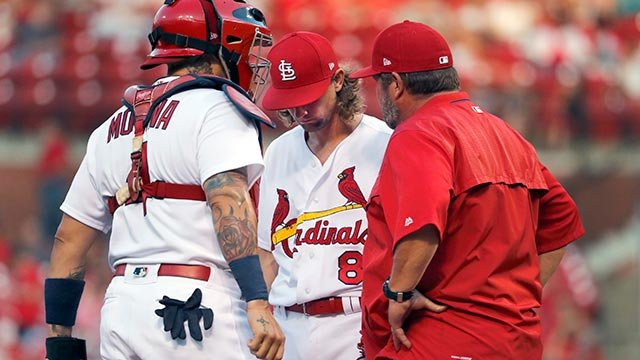 St. Louis Cardinals pitching coach Derek Lilliquist, right, talks with starting pitcher Mike Leake, center, as catcher Yadier Molina listens during a game against the Milwaukee Brewers (Credit: AP Photo / Jeff Roberson)