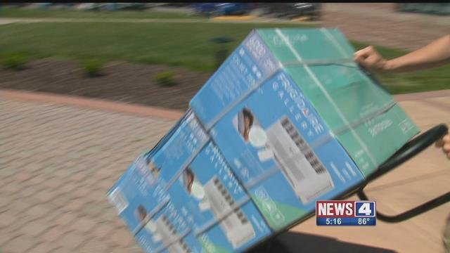 Ameren Illinois handed air conditioners to those in need on Monday. Credit: KMOV