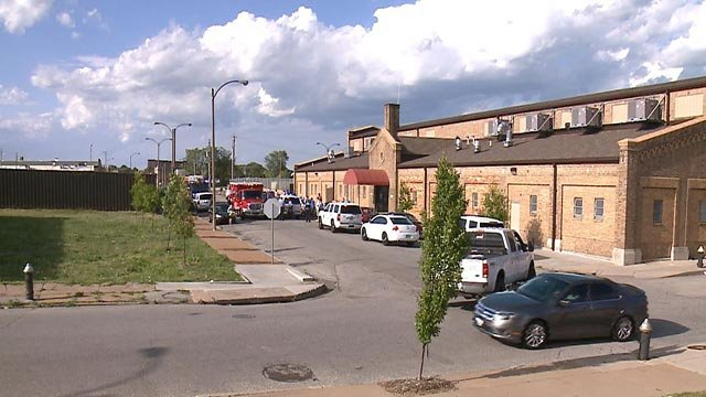Emergency vehicles outside Biddle House after a man was stabbed Monday (Credit: KMOV)