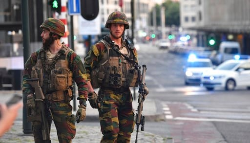 Belgian Army soldiers patrol outside Central Station after a reported explosion in Brussels on Tuesday, June 20, 2017. (AP Photo/Geert Vanden Wijngaert)