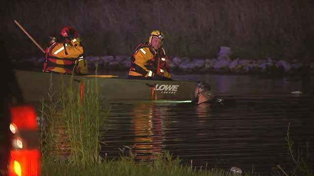 Authorities say a car went off an Alorton road and into a retention pond. Credit: KMOV