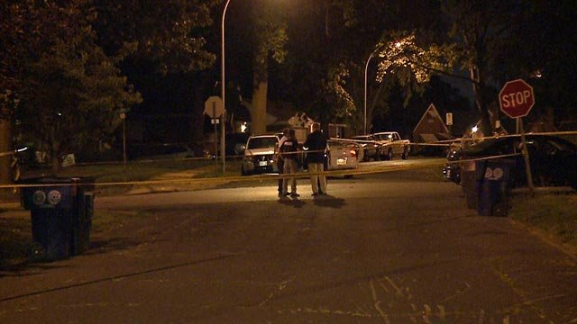 Investigators on Astra Avenue Wednesday night (Credit: KMOV)