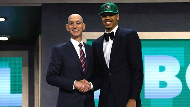 Jayson Tatum walks on stage with NBA commissioner Adam Silver after being drafted third overall by the Boston Celticsduring the first round of the 2017 NBA Draft at Barclays Center on June 22, 2017. Credit: Getty Images