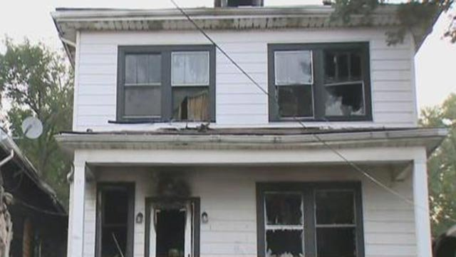 A home in the 3900 block of Schiller Place following a fire Friday (Credit: KMOV)