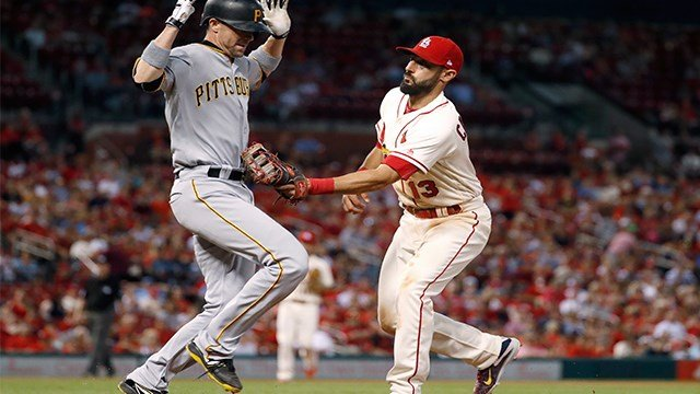 Pittsburgh Pirates' Chris Stewart, left, is tagged out by St. Louis Cardinals first baseman Matt Carpenter during the eighth inning of a baseball game Saturday, June 24, 2017, in St. Louis. (AP Images)