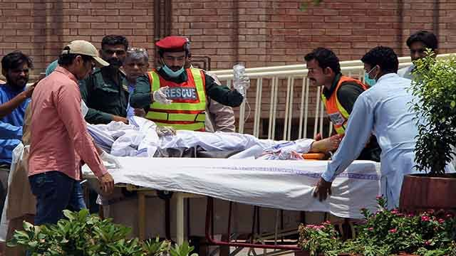 Pakistani rescue worker and hospital staff transport a victim of an oil tanker explosion at a hospital in Multan, Pakistan, Sunday, June 25, 2017. An overturned oil tanker burst into flames in Pakistan on Sunday, killing scores of people who had rushed to
