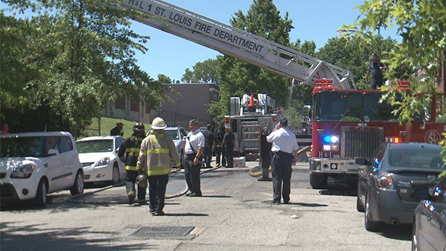 A St. Louis firefighter is in stable condition after falling through a roof in the 2700 block of Bacon on Sunday.(Credit: KMOV)