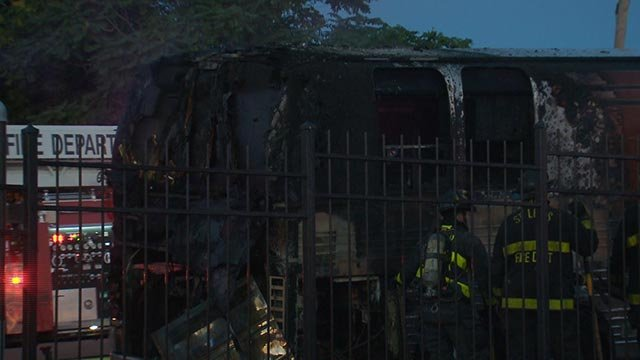 A tour bus caught fire at 4th & Chouteau around 4 a.m. (Credit: KMOV)